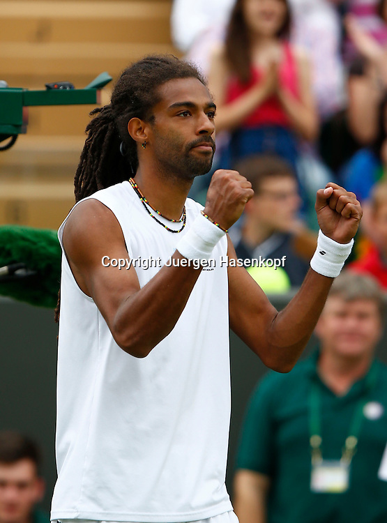 Wimbledon Championships 2013, AELTC,London,<br /> ITF Grand Slam Tennis Tournament,<br /> Dustin Brown (GER) hebt die Faeuste und jubelt nach seinem Sieg,<br /> Jubel,Einzelbild,Halbkoerper,Hochformat,