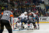 KELOWNA, CANADA - SEPTEMBER 24: Cal Foote #25 of the Kelowna Rockets checks Jermaine Loewen #32 of the Kamloops Blazers on September 24, 2016 at Prospera Place in Kelowna, British Columbia, Canada.  (Photo by Marissa Baecker/Shoot the Breeze)  *** Local Caption *** Jermaine Loewen; Cal Foote;