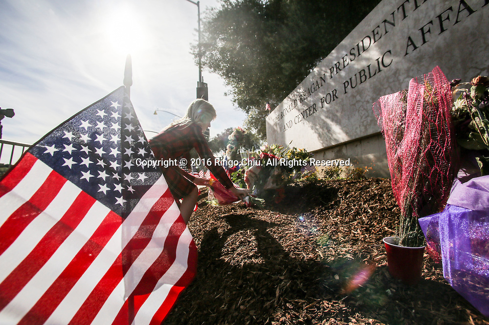 People lay flowers at a makeshift memorial for the late Nancy Reagan outside the Ronald Reagan Presidential Library in Simi Valley, California on March 10, 2016. Former US first lady Nancy Reagan was lying in repose at her husband's presidential library on, with members of the public paying their last respects ahead of a private funeral. (Photo by Ringo Chiu/PHOTOFORMULA.com)<br /> <br /> Usage Notes: This content is intended for editorial use only. For other uses, additional clearances may be required.