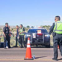 McKinley County Deputy Sheriff Paul Lucero, left, stands with DWI Program employees Maura Schanefelt and Domnick Riffle as well as Chief Medical Investigator Richard Malone as Gallup Police Lt. Francie Martinez awaits passing motorists during the DWI Joint Task Force Checkpoint Tuesday afternoon on New Mexico Highway 602 near Park Avenue in Gallup.