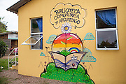 A painting on the side of the wall at the community library, Biblioteca Comunitaria do Arquipelago, Porte Alegre, Brazil. <br /> <br /> Cirandar is working in partnership with  C&A and C&A Instituto to implement a network of Community Libraries in eight communities of Porto Alegre.