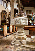 Historic interior of East Bergholt church, Suffolk, England, UK baptismal font