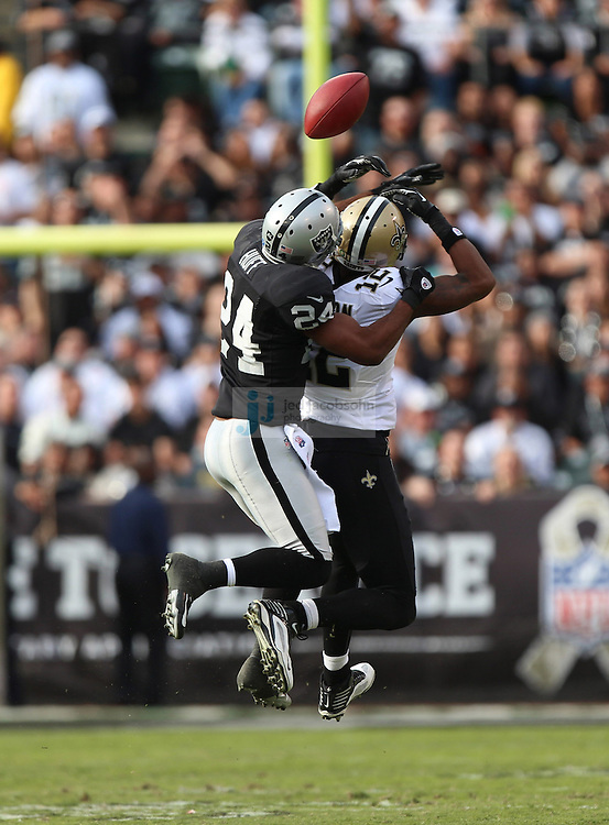 Oakland Raiders safety Michael Huff (24) and New Orleans Saints wide receiver Marques Colston (12) in action during an NFL game on Sunday, Nov. 18, 2012 at the Oakland Coliseum in Oakland, Ca. (AP Photo/Jed Jacobsohn)