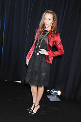 OLIVIA GRANT at a party to celebrate the launch of the new 2&8 club at Morton's Berkeley Square, London on 27th September 2012.