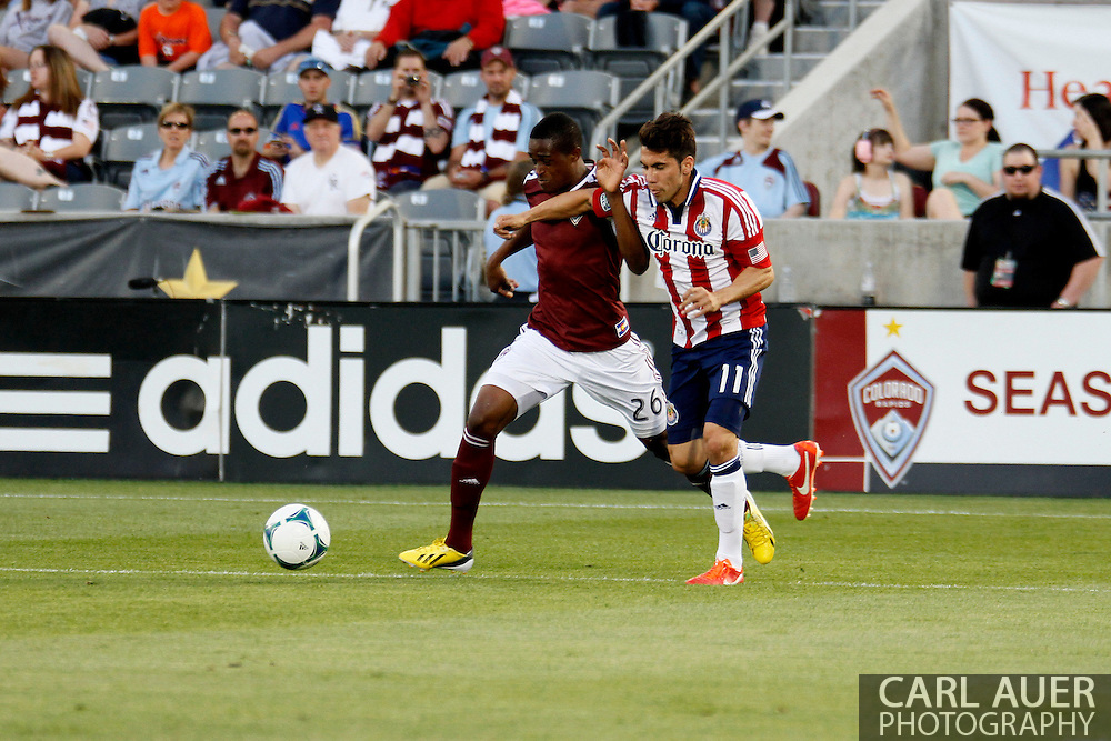 May 25th, 2013 Commerce City, CO - Colorado Rapids forward Deshorn Brown (26) and Chivas USA midfielder Gabriel Farfan (11) battle for the ball in the first half of the MLS match between Chivas USA and the Colorado Rapids at Dick's Sporting Goods Park in Commerce City, CO