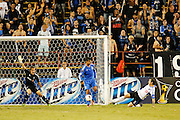 Montreal Impact goalkeeper Evan Bush (30) shouts to his teammates as San Jose Earthquakes forward Chris Wondolowski (8) attacks the goal in the second half of the game at Buck Shaw Stadium in Santa Clara, California, on September 17, 2013.  The San Jose Earthquakes beat Montreal Impact 3-0. (Stan Olszewski/QMI Agency)