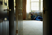Lee, 26, from West London, is having a cigarette while sitting in a large empty room inside the just entered Winningon Road mansion on Friday, Oct. 19, 2007 in Hampstead, London, England. The residence, 89 Winnington Road, was former Indonesian President Haji Mohamed Suharto's top London mansion and was sold in 1999 for UK£ 9.5M when he was being investigated in his home country in regards to his fortune and extravagant lifestyle. Million Dollar Squatters is a documentary project in the lives of a peculiar group of squatters residing in three multi-million mansions in one of the classiest residential neighbourhoods of London, Hampstead Garden. The squatters' enthusiasm, their constant efforts to look after what has become their home, their ingenuity and adventurous spirit have all inspired me throughout the days and nights spent at their side. Between the fantasy world of exclusive Britain and the reality of squatting in London, I have been a witness to their unique story. While more than 100.000 properties in London still lay empty to this day, squatting provides a valid, and lawful alternative to paying Europe's most expensive rent prices, as well as offering the challenge of an adventurous lifestyle in the capital.