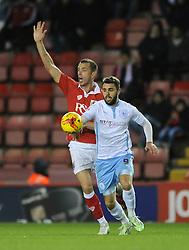 Bristol City's Aaron Wilbraham appeals for a handball against Coventry City's Josh McQuaid - Photo mandatory by-line: Dougie Allward/JMP - Mobile: 07966 386802 - 10/12/2014 - SPORT - Football - Bristol - Ashton Gate Stadium - Bristol City v Coventry City - Johnstone's Paint Trophy