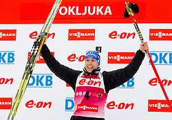 Winner BIRNBACHER Andreas of Germany celebrates during flower ceremony after the Men 15 km Mass start competition of the e.on IBU Biathlon World Cup on Thursday, December 16, 2012 in Pokljuka, Slovenia. The third e.on IBU World Cup stage is taking place in Rudno polje - Pokljuka, Slovenia until Sunday December 16, 2012. (Photo By Vid Ponikvar / Sportida.com)
