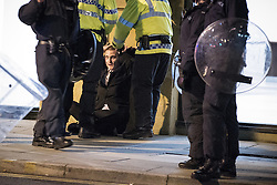 © Licensed to London News Pictures . 09/08/2011 . Manchester , UK . Police detain a man in Piccadilly , as disorder spreads to Manchester during a 4th night of rioting and looting , following a protest against the police shooting of Mark Duggan in Tottenham . Photo credit : Joel Goodman/LNP