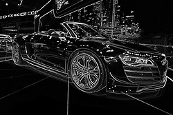 08  February 2013: Audi R8 GT Spyder convertible sports car.  Chicago Auto Show, Chicago Automobile Trade Association (CATA), McCormick Place, Chicago Illinois..<br /> <br /> This image was produced in part utilizing High Dynamic Range (HDR) or panoramic stitching or other computer software manipulation processes. It should not be used editorially without being listed as an illustration or with a disclaimer. It may or may not be an accurate representation of the scene as originally photographed and the finished image is the creation of the photographer.
