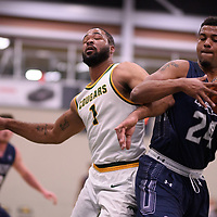 4th year forward Shawn Lathan (1) of the Regina Cougars during the Men's Basketball home game on January 5 at Centre for Kinesiology, Health and Sport. Credit: Arthur Ward/Arthur Images