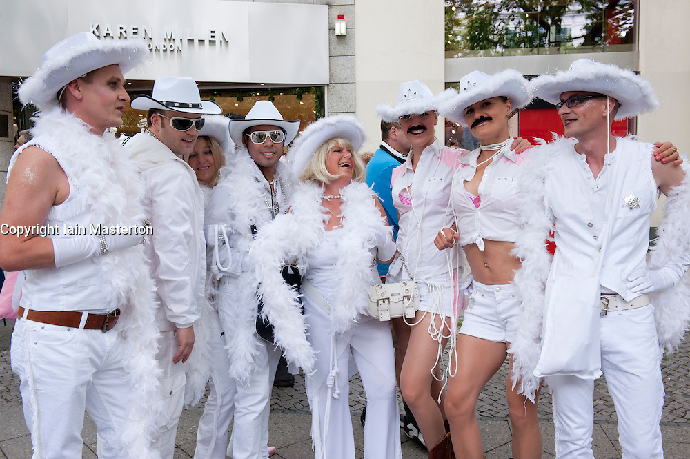 Group of people dressed as cowboys at Christopher Street Day Parade in Berlin Germany 2011