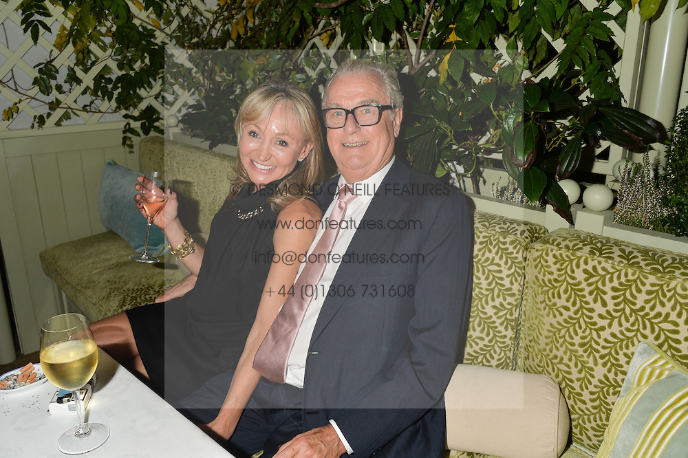 LORD BELL and JACKY PHILLIPS at a party to celebrate the publication of Right or Wrong: The Memoirs of Lord Bell held at Mark's Club, Charles Street, London on 16th October 2014.