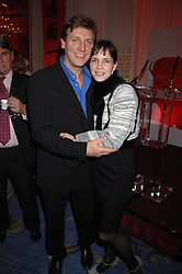 DARCEY BUSSELL and her husband ANGUS FORBES at a party hosted by the Mandarin oriental Hyde park Hotel to celebrate the Chinese new year on 19th February 2007.<br />