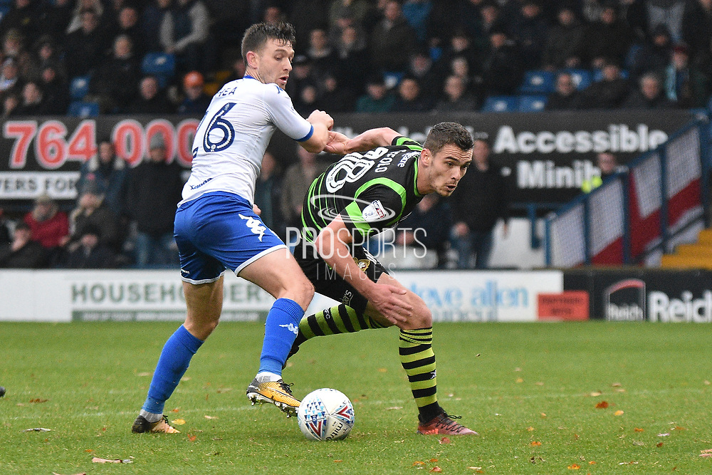 Bury Midfielder, Jay O'Shea (26) and Doncaster Rovers Defender, Harry Toffolo (18)  during the EFL Sky Bet League 1 match between Bury and Doncaster Rovers at the JD Stadium, Bury, England on 28 October 2017. Photo by Mark Pollitt.
