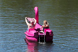 © Licensed to London News Pictures. 22/06/2019. Warwick, Warwickshire, UK. A man on a pedalo removes his shirt as they enjoy the weather on the river Avon in Warwick during a hot summers day. Photo credit: LNP