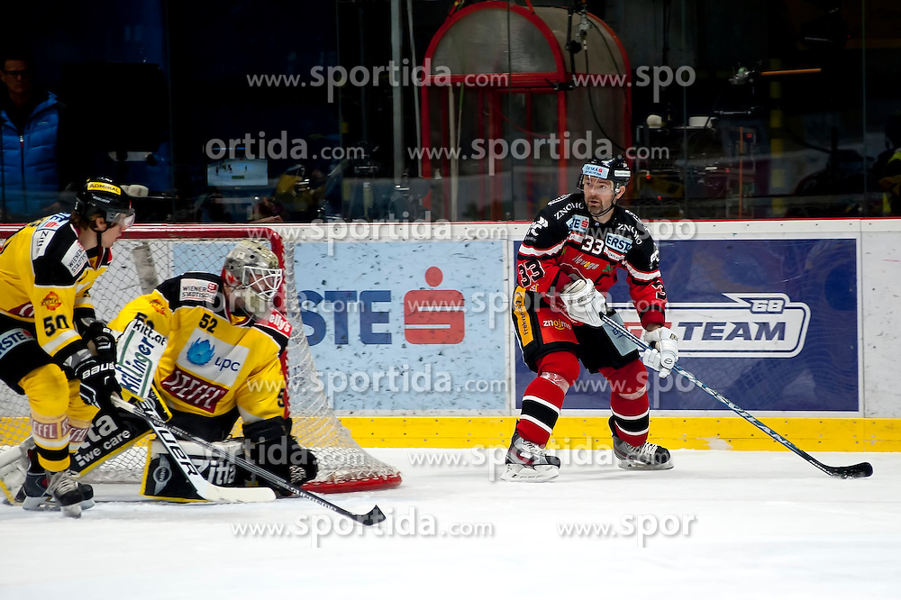 11.10.2015, Ice Rink, Znojmo, CZE, EBEL, HC Orli Znojmo vs UPC Vienna Capitals, 10. Runde, im Bild v.l. Mario Fischer (UPC Vienna Capitals) Nathan Lawson (UPC Vienna Capitals) Peter Pucher (HC Orli Znojmo) // during the Erste Bank Icehockey League 10th round match between HC Orli Znojmo and UPC Vienna Capitals at the Ice Rink in Znojmo, Czech Republic on 2015/10/11. EXPA Pictures © 2015, PhotoCredit: EXPA/ Rostislav Pfeffer