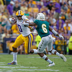 Sep 8, 2018; Baton Rouge, LA, USA; LSU Tigers wide receiver Stephen Sullivan (10) stiff arms Southeastern Louisiana Lions defensive back Dejion Lynch (6) during the first quarter of a game at Tiger Stadium. Mandatory Credit: Derick E. Hingle-USA TODAY Sports