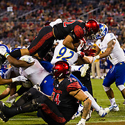 20 October 2018: San Diego State Aztecs running back Chase Jasmin (22) dives into the end zone for a touchdown in the second quarter giving the Aztecs a 7-6 lead. The Aztecs beat the Spartans 16-13 Saturday night at SDCCU Stadium.