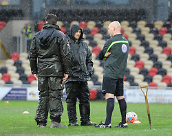 Referee Charles Breakspear consults with ground staff at Rodney Parade ahead of FA Cup tie between Newport County and Blackburn Rovers - Mandatory by-line: Paul Knight/JMP - Mobile: 07966 386802 - 09/01/2016 -  FOOTBALL - Rodney Parade - Newport, Wales -  Newport County v Blackburn Rovers - FA Cup third round