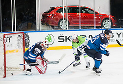Ziga Jeglic of Slovenia vs Harri Sateri of Finland and Topi Jaakola of Finland during the 2017 IIHF Men's World Championship group B Ice hockey match between National Teams of Finland and Slovenia, on May 10, 2017 in AccorHotels Arena in Paris, France. Photo by Vid Ponikvar / Sportida