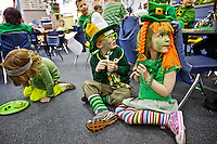 "Kate Murray, right, and Luke Neary, dressed in their best St. Patrick's Day attire, wait for instructions from their teacher Wednesday at KinderMagic in Coeur d'Alene. Kindergarten students donned everything green for their classroom celebration of St. Patrick's Day complete with a ""green feast"" for lunch, Irish jigs and songs."