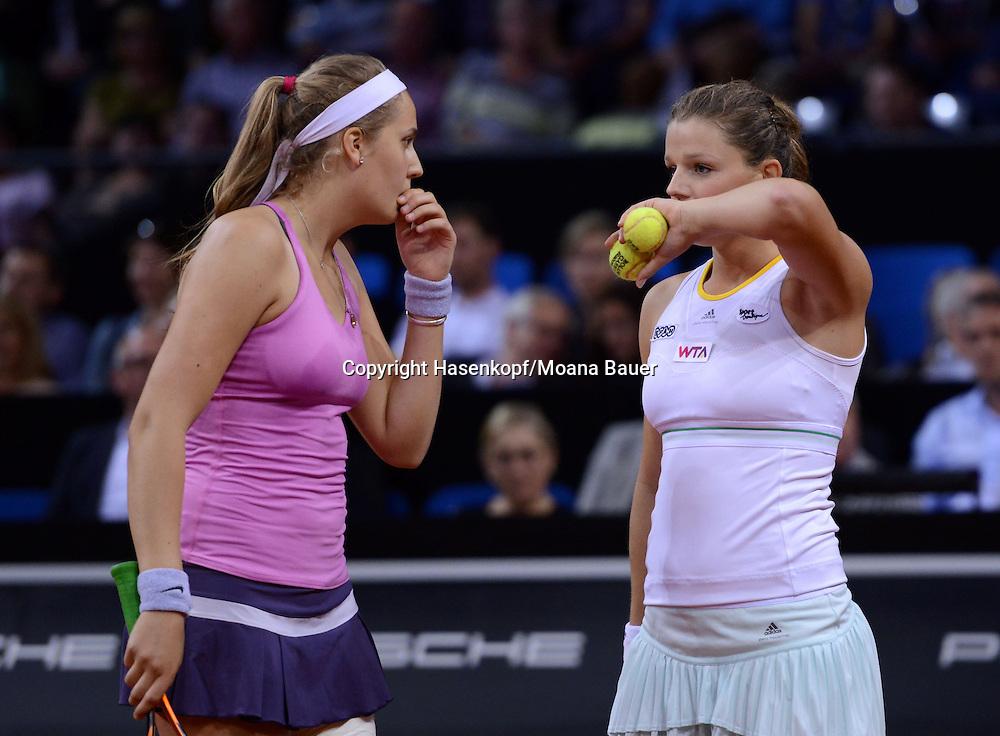 Porsche Grand Prix 2014 in Stuttgart, internationales WTA Damen Tennis Turnier, Porsche Arena,L-R, Antonia Lottner (GER) und Anna Zaja (GER) besprechen Taktik in ihrem Doppelmatch.