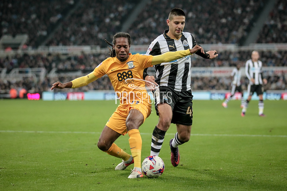 Daniel Johnson (Preston North End) and Aleksandar Mitrović (Newcastle United) during the EFL Cup 4th round match between Newcastle United and Preston North End at St. James's Park, Newcastle, England on 25 October 2016. Photo by Mark P Doherty.