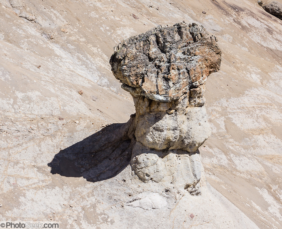 Erosion created a hoodoo (rock pinnacle) at Punta Cuyoc (a pass at 16,200 feet or 4950 m) in the Cordillera Huayhuash, Andes Mountains, Peru, South America. Geology: Cordillera Huayhuash is comprised of uplifted sedimentary sea floor rocks (quartzite, limestone, slate) with a base of granodiorite. Day 5 of 9 days trekking around the Cordillera Huayhuash.