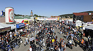 STURGIS, SOUTH DAKOTA - AUGUST 2010:  Motorcyclists gather on Main Street in downtown Sturgis, South Dakota during the 70th annual Sturgis Motorcycle Rally held in the Black Hills.  The attendance estimates were placed between 500, 000 and 700,000 bikers.