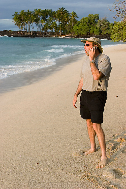 Phillip Greenspun talking on his cellphone on Pu'u Kala beach, Big Island of Hawaii. MODEL RELEASED.