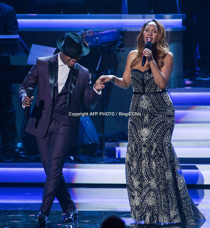 Performer Ne-Yo, left, and Aisha Morris, daughter of Stevie Wonder, perform at a concert, Stevie Wonder: Songs In The Key Of Life - An All-Star GRAMMY Salute, at Nokia Theatre L.A. Live on February 10, 2015 in Los Angeles, California. AFP PHOTO / Ringo Chiu