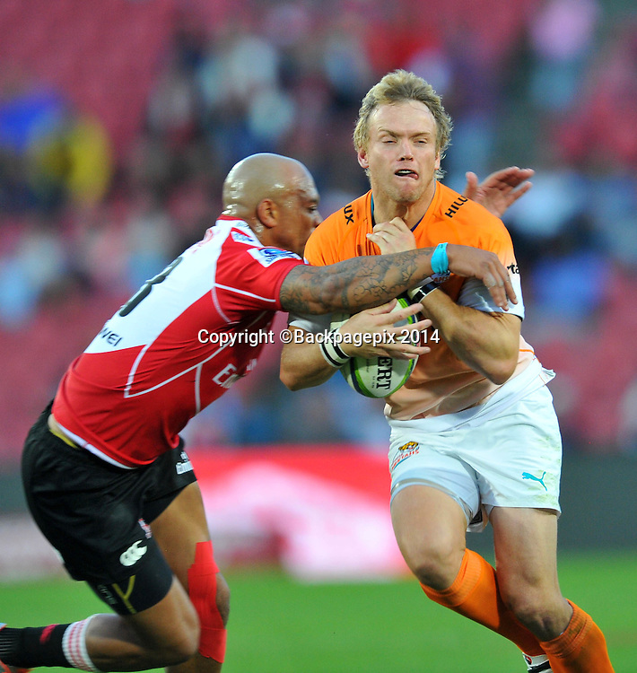 Joe Pietersen of the Cheetahs tackled by Lionel Mapoe of the Lions during the 2015 Super Rugby match between the Lions and the Cheetahs at the Ellis Park Stadium in Johannesburg, South Africa on April 25, 2015 ©Samuel Shivambu/BackpagePix