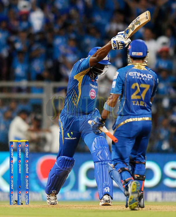 Kieron Pollard of the Mumbai Indians celebrates after hitting the winning run during match 22 of the Pepsi Indian Premier League Season 2014 between the Mumbai Indians and the Kings XI Punjab held at the Wankhede Cricket Stadium, Mumbai, India on the 3rd May  2014<br /> <br /> Photo by Pal Pillai / IPL / SPORTZPICS<br /> <br /> <br /> <br /> Image use subject to terms and conditions which can be found here:  http://sportzpics.photoshelter.com/gallery/Pepsi-IPL-Image-terms-and-conditions/G00004VW1IVJ.gB0/C0000TScjhBM6ikg