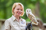 DAWN GRIFFARD OF WORLD BIRD SANCTUARY POSES WITH ANIMALS