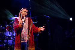 © Licensed to London News Pictures . 15/09/2013 . Bury , UK . SINEAD O'CONNOR performing as the closing act of the Ramsbottom Festival , in Bury , this evening (Sunday 15th September) . The singer made headlines recently after revealing new tattoos of the letters B and Q on each of the cheeks of her face . Photo credit : Joel Goodman/LNP