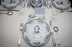 © Licensed to London News Pictures. 10/12/2012. London, UK. A plate bearing the portrait of Charles Dickens is seen at the author's former dining table in the Charles Dickens Museum which re-opened in London today (10/12/12). The museum, spread over 4 floors, is housed in the building where Dickens lived with his wife from March 1837 to December 1839 and where he authored some of his famous titles including the Pickwick Papers, Nicholas Nickleby and Oliver Twist. Photo credit: Matt Cetti-Roberts/LNP