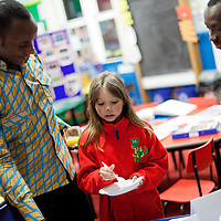 Picture Shows : Teachers Ayakwa Kwabena, Patrick Asiedu of Juliet Johnson School, Ghana serve up some Ghana food..Muthill Primary School, Muthill by Crieff, Perthshire, Scotland stage an evening of international cooking to celebrate their joint work with a partner school Juliet Johnson School, Ghana which is visiting this week. They have strong links with the Ghanians and have helped to raise money to contribute toward funding a new school bus.   Feature for TESS..Picture Drew Farrell Tel : 07721-735041