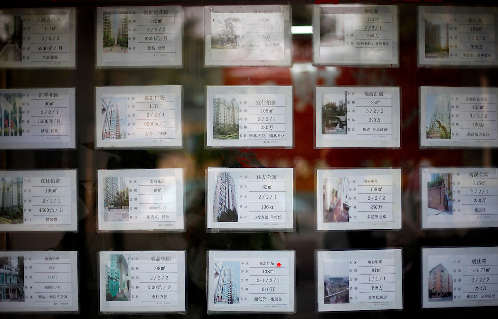 Postings for real estate are advertised on the window of property agents in Shanghai, China, Friday, May 29, 2009.Block after city block, towers of concrete, steel and glass fill the skyline. .Teeming and congested, the intensely urban landscapes of China's biggest cities show a glimpse of what the future will hold for the rest of the country.In the sprawling megacities of Beijing, Shanghai and Chongqing, where populations exceed 10 million people, extreme urban density means that the number of people living within a few square blocks here is equal to the population of entire mid-size U.S. cities. .China's urban population soared to 607 million people last year _ nearly equaling the 700 million living in the countryside. The country's headlong plunge toward urbanization continues unabated as tens of millions of migrants from the countryside flood to cities in search of money, jobs and other opportunities.