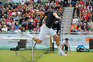 Picture by Ste Jones/Focus Images Ltd.  07706 592282.23/06/12.Greg Rusedski (GBR) jumps the net to play his return ball during the +medicash Liverpool International 2012 tennis at Calderstones Park, Liverpool.