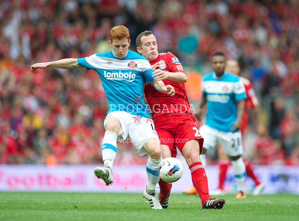 LIVERPOOL, ENGLAND - Saturday, August 13, 2011: Liverpool's Charlie Adam in action against Sunderland's Jack Colback during the Premiership match at Anfield. (Pic by David Rawcliffe/Propaganda)