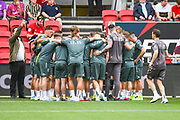 Leeds United players huddle during the warm up during the EFL Sky Bet Championship match between Bristol City and Leeds United at Ashton Gate, Bristol, England on 4 August 2019.