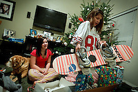 Rheana Pollos lifts her new snowboard out of a box on Christmas morning 2010. She also received a Vernon Davis San Francisco 49ers jersey that was listed as a children's small, but was way too big.