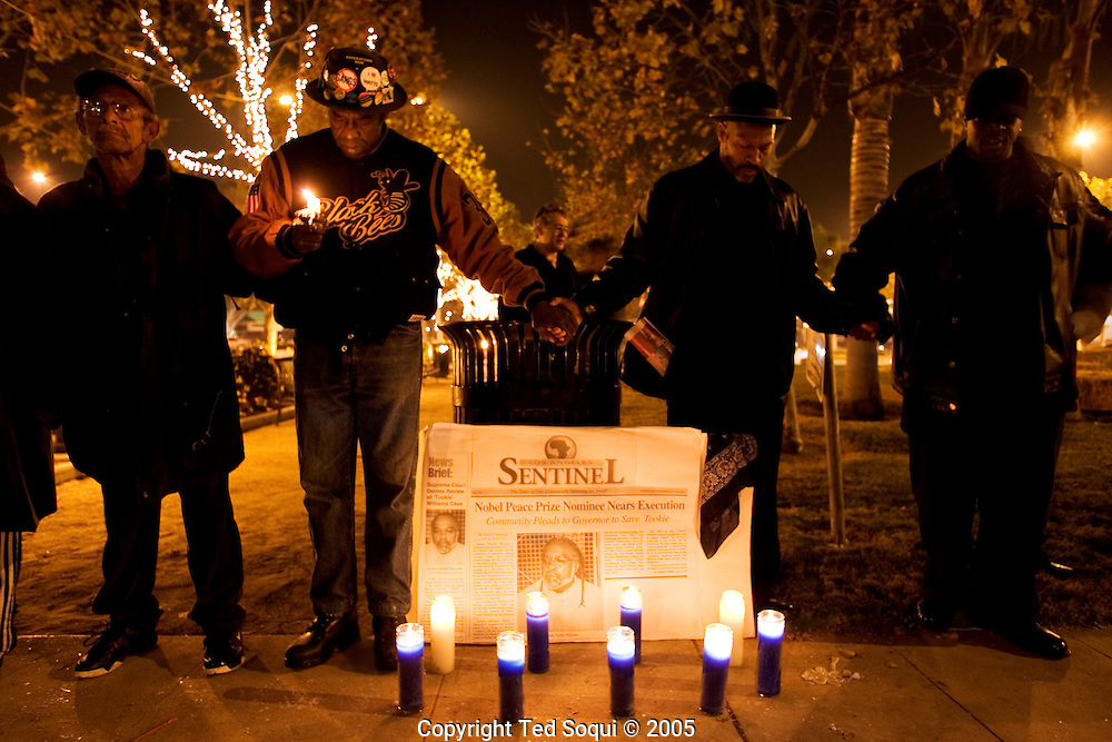 """Los Angeles residents gather and pray as Stanley """"Tookie"""" Williams is executed in San Quinten's death chamber around midnight. People have gathered throughout the day at Leimert Park in South Central LA to remember """"Tookie""""."""