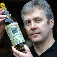 Derek Brown of Famous Grouse Whisky who are appealing for old 'Grouse related items' for the new 'Famous Grouse experience being constructed at Glenturret Distillery.<br />Derek is pictured an old bottle of Famous Grouse Whisky<br />See press release by Jackie Martin on 01738 493640<br /><br />Picture by Graeme Hart.<br />Copyright Perthshire Picture Agency<br />Tel: 01738 623350  Mobile: 07990 594431