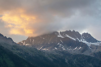 Sunset glow over Hermit Range Selkirk Mountains. Glacier Natioan Park British Columbia.