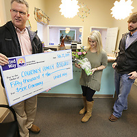 Jeff King with Community Bank and Chairman of the Board with the United Way presents Courtney Cowley, and her husband Kevin with the $50,000.00 check she won from United Way on Friday in Tupelo.
