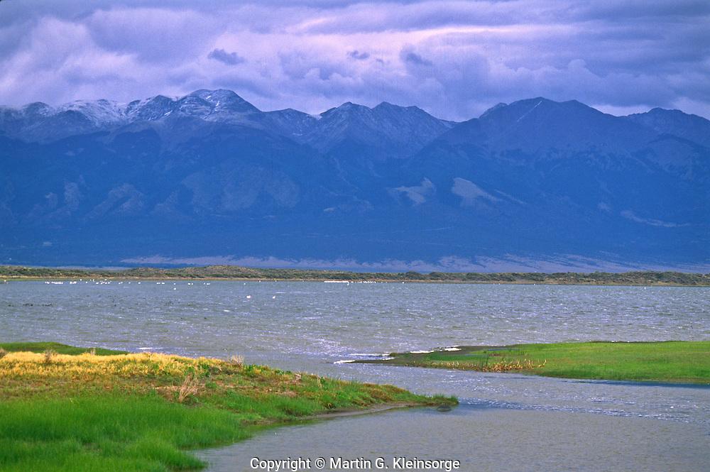 San Luis Lake below the Sangre De Cristo Mountains.  San Luis State Park, Colorado.