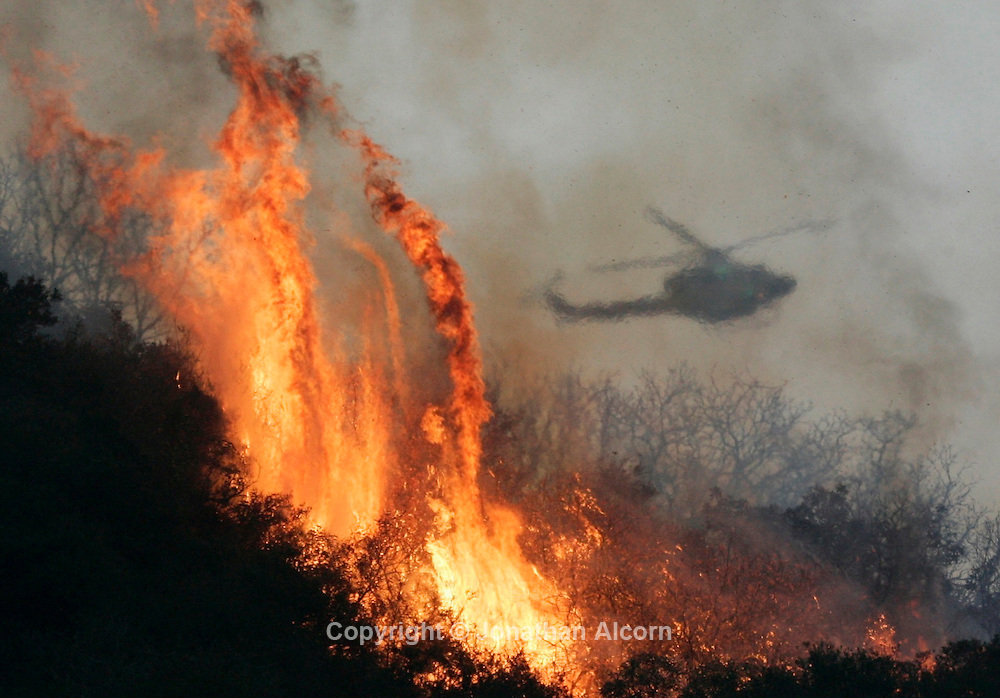 Aug. 26, 2009 - La Canada-Flintridge, California, U.S. - A  firefighting helicopter works the Station fire  just off of Angeles Crest Highway, about 15 miles north of downtown Los Angeles.